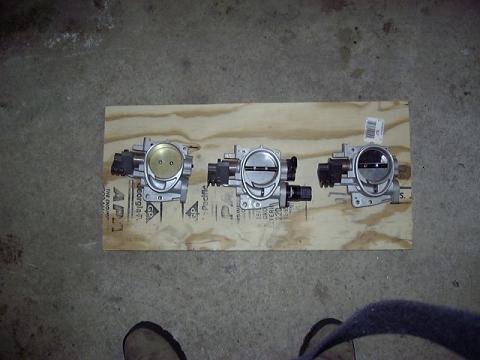 Left to right, bored TB, stock automatic tranny TB, stock manual tranny TB